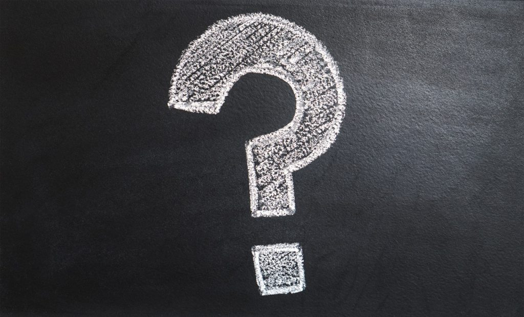 Bold Question Mark on Chalkboard
